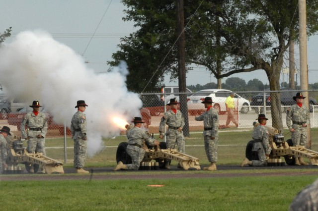 FORT HOOD, Texas- The salute battery from 2nd Battalion, 82nd Field Artillery Regiment, 3rd Brigade Combat Team, 1st Cavalry Division, fires a single volley for each state during the fifty-gun salute to the Union during Fort Hood's Freedom Festival at Fort Hood Stadium, July 4.