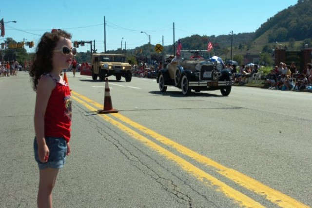 CANONSBURG, Pa. -- A young girl watches as the Army Reserve passes by during the Fourth of July parade here Saturday, July 3.  Approximately 50,000 people attended the event- making it one of the state's largest parades.  Canonsburg is the home of Perry Como, Bobby Vinton and the Four Coins. This year marked the 48th anniversary of the town's parade.