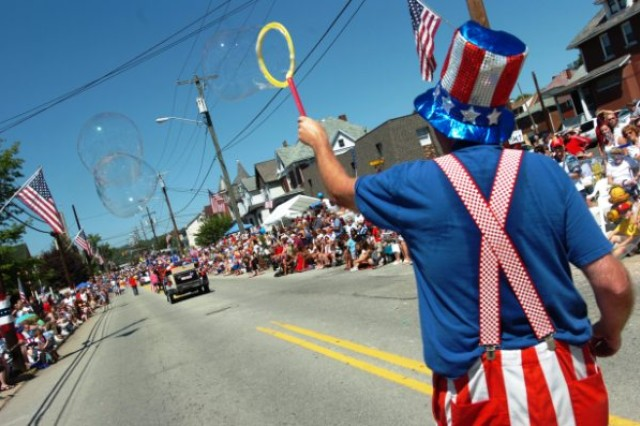 CANONSBURG, Pa. -- A clown stops to blow bubbles and entertain children during the Fourth of July parade here on Saturday, July 3.  This is the parade's 48th year and it only continues to build momentum.  Already one of the state's largest parades, the event attracts approximately 50,000 people every year.