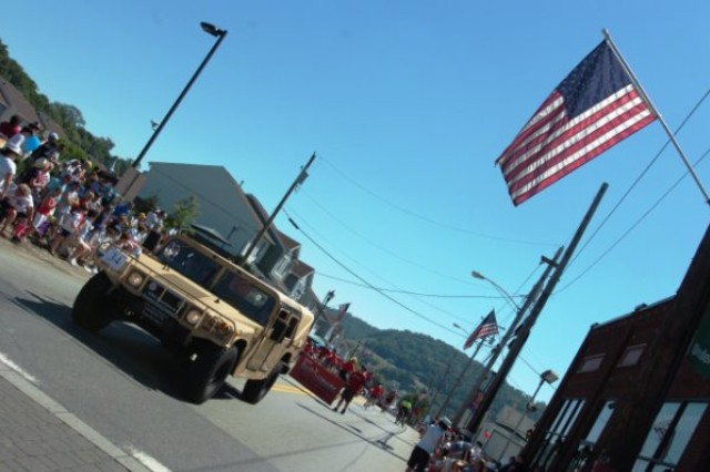 CANONSBURG, Pa. -- A High Mobility Multipurpose Wheeled Vehicle, or humvee, passes down the parade route on Saturday, July 3 during the Canonsburg Fourth of July parade.  The humvee belongs to the 301st Regional Support Group, Butler, Pa. Three Army Reserve Soldiers participated in the parade, which is one of the largest in the state- attracting approximately 50,000 people.