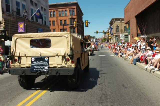 """CANONSBURG, Pa. -- Soldiers from the 301st Regional Support Group, Butler, Pa., participated in this year's Fourth of July parade on Saturday, July 3.  The higher headquarters for the 301st RSG is the 316th Expeditionary Sustainment Command, Coraopolis, Pa. This year's parade theme was """"Honoring those who have served"""" and included guest speaker Col. Lewis Irwin, commander of the 301st RSG.  The grand marshal of the parade was singer Bobby Vinton, a native of Canonsburg."""