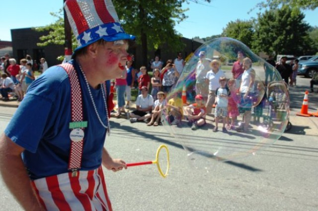 CANONSBURG, Pa. -- Bubbles, bubbles everywhere.  This clown entertained children by blowing bubbles into the crowd during this year's Fourth of July parade on Saturday, July 3.  The clown was one of many participants that braved the heat and celebrated the holiday with more than 50,000 people from around the state. This was the 48th anniversary for the parade that continues to be one of the largest in the state.