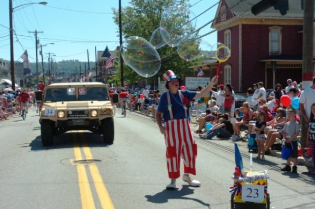 """CANONSBURG, Pa. -- A clown walked alongside the Army Reserve during the Fourth of July parade here Saturday, July 3.  The parade, which was celebrating its 48th year, is one of the largest in the state.  More than 50,000 people attended the event despite the rising temperatures. The 301st Regional Support Group, in Butler, Pa., sent three Soldiers to participate in the event.  Col. Lewis Irwin, commander of the 301st RSG, was a guest speaker during the parade which was themed, """"Honoring those who have served."""""""