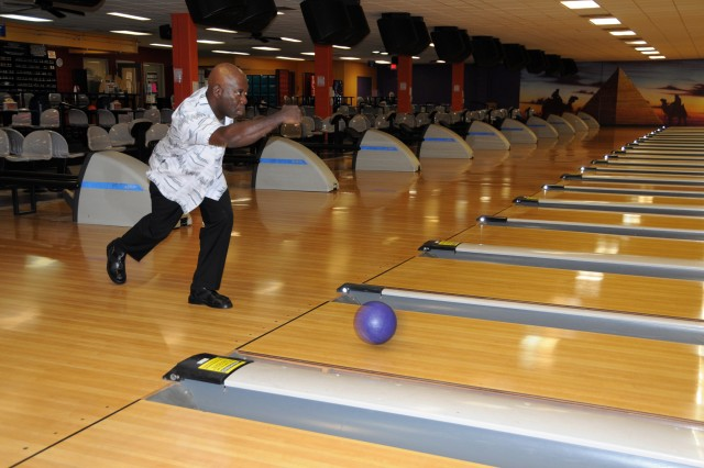 Retired Soldier Ivy Sarvis throws a strike as he shows off the bowling form that led him to bowl a perfect 300 game at Marne Lanes at Fort Stewart, June 22.
