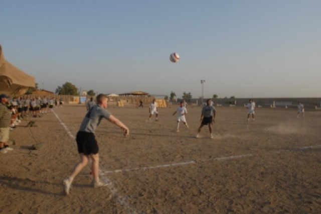 A 1st Battalion, 15th Infantry Regiment, 3rd Heavy Brigade Combat Team, 3rd Infantry Division player throws the ball to a teammate during their match versus the Iraqi Police team July 4 at Contingency Operating Site Echo, Iraq. The Brothers-In-Arms Soccer Tournament gave Soldiers from different countries a chance to come together with soccer as a common interest.