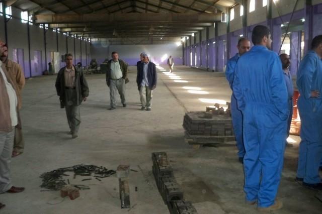 Members of the Maysan Provincial Reconstruction Team evaluate a plastics factory in Al Amarah in June.