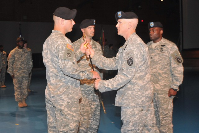 Command Sgt. Maj. David Martel (right) Regimental Sgt. Maj. for the Old Guard, passes the NCO sword to Command Sgt. Maj. Phillip R. Cantrell, incoming Command Sgt. Maj. for 4th Battalion, 3d Infantry Regiment, during a Change of Responsibility ceremony at Conmy Hall on Fort Myer, Va., July 9. The transfer of the NCO sword signifies the relinquishing of responsibility and authority from the outgoing to the incoming Command Sgt. Maj. (Photo by Staff Sgt. Adora Gonzalez)