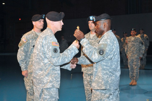 Sgt. Maj. Reginald Cooper (right), outgoing Command Sgt. Maj. for 4th Battalion, 3d Infantry Regiment, passes the NCO sword to Command Sgt. Maj. David Martel, Regimental Sgt. Maj. for the Old Guard, during a Change of Responsibility ceremony at Conmy Hall on Fort Myer, Va., July 9. The transfer of the NCO sword signifies the relinquishing of responsibility and authority from the outgoing to the incoming Command Sgt. Maj. (Photo by Staff Sgt. Adora Gonzalez)