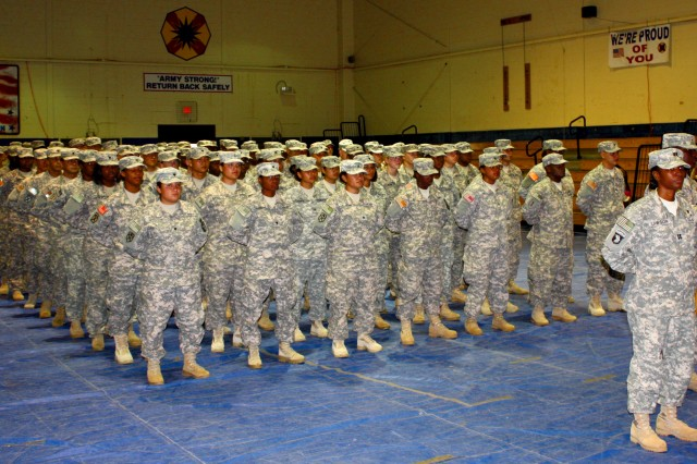 Capt. Anjeanette Lawson, commander of the 289th Quartermaster Company, 553rd Combat Sustainment Support Battalion, 4th Sustainment Brigade, 13th Sustainment Command (Expeditionary), and approximately 130 of her Soldiers stand in formation during a farewell ceremony at the Kieschnick physical fitness center July 1 at Fort Hood, Texas. The unit deployed to Iraq July 3. (U.S. Army photo by Spc. Andrew Parks)