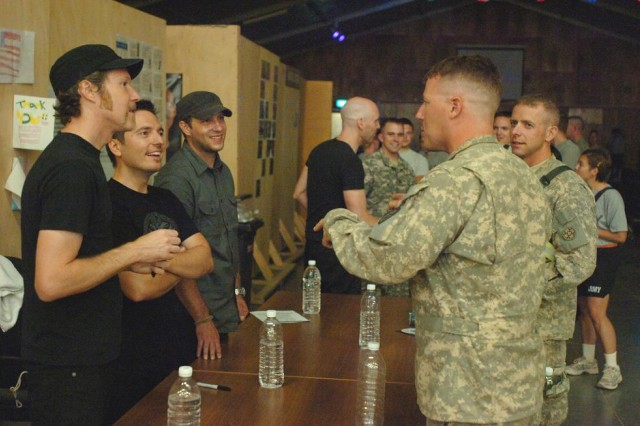 Vertical Horizon, an alternative rock, post-grunge rock band from Washington, D.C., signs autographs and CDs for Soldiers and other attendees after a concert at Contingency Operating Base Speicher's South Morale, Welfare and Recreation facility,