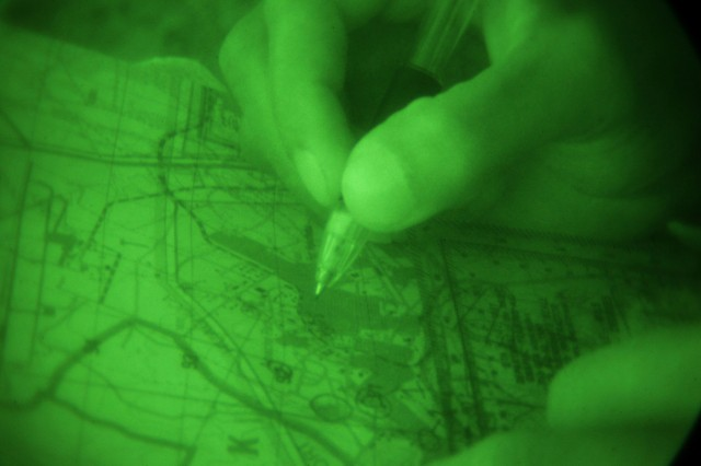 Sgt. LeMarquis Jackson, 311th Signal Command (Theater), plots a point on a map during the nighttime urban orienteering portion of the U.S. Army Network Enterprise Technology Command/9th Signal Command (Army) Noncommissioned Officer and Soldier of the Year competition, June 16.