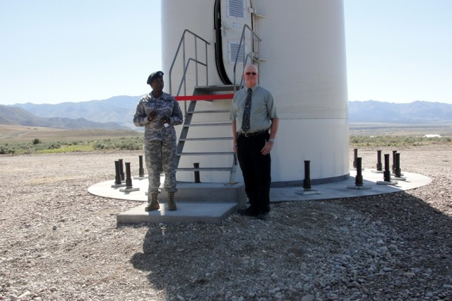 Col. Yolanda Dennis-Lowman, Tooele Army Depot commander, addresses guests at the ribbon-cutting ceremony for the depot's first wind turbine.  Dennis-Lowman shared the ribbon-cutting duties with Jay Weyland, right, the depot's energy manager, who made the turbine project happen. Upon cutting the ribbon they both went into the turbine and turned the switch that began spinning the turbine blades.