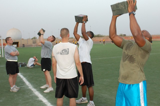 CAMP LEMONNIER, Djibouti - Members of the Combined Joint Task Force-Horn of Africa rifle team lift 30-pound ammo cans during conditioning drills July 5, 2010. The team is undergoing an intense two-month long conditioning drill to prepare them for the Kenya Armed Forces Rifle Championship Sept. 20-24.