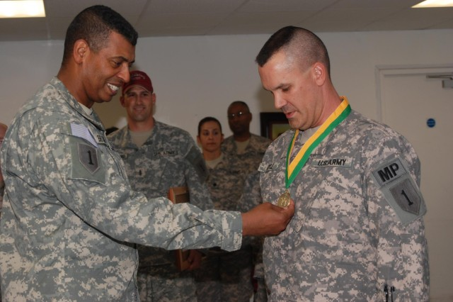 Maj. Jonathan Doyle, the 1st Infantry Division provost marshal, receives the Order of the Marechaussee from Maj. Gen. Vincent K. Brooks, United States Division-South commander, July 3. The award is one of the highest honors bestowed upon a military policeman in the Military Police Regimental Association.