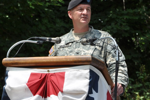 In his first official words as arsenal commander, Col. Mark F. Migaleddi speaks to civic and political leaders, as well as to several hundred of the arsenal workforce.