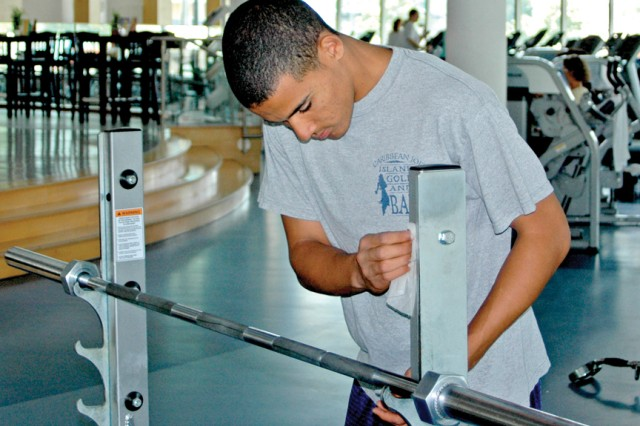 Summer hire employee Brian Sealey helps keeps the equipment looking good at the Wiesbaden Fitness Center.