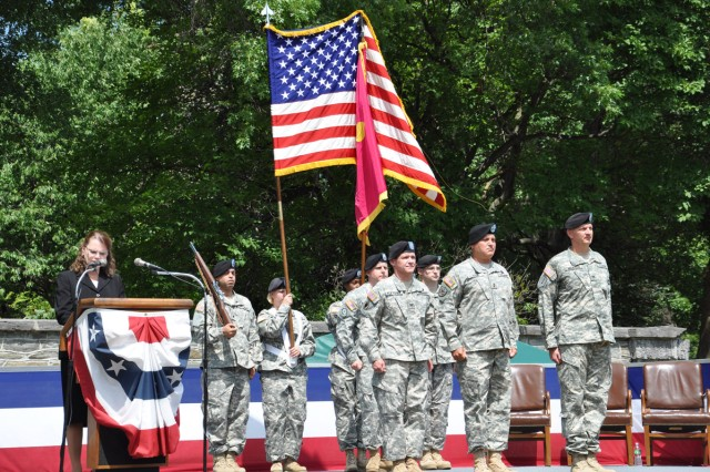 While Arsenal Operations Officer, Lauren Smith, keeps the change of command flow going, Col. Scott N. Fletcher, Maj. Gen. Kurt J. Stein, and Col. Mark F. Migaleddi stand ready to execute the passing of the colors.  From left to right, Fletcher, Stein, and Migaleddi.