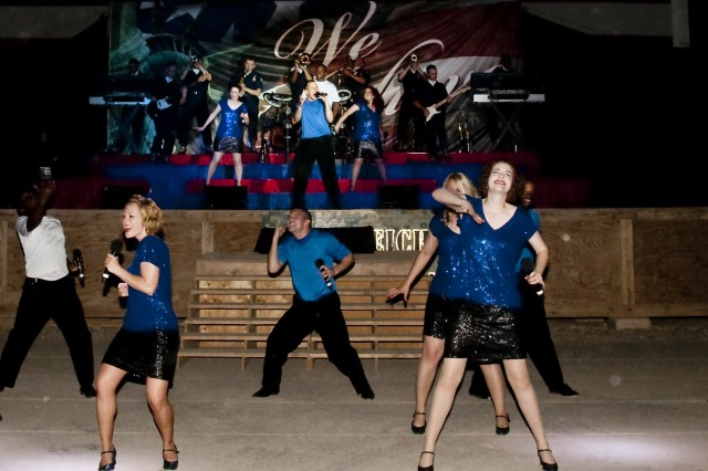 Airmen of the Top in Blue entertainment unit sing and dance for the Soldiers, Sailors, Airmen and Marines of Contingency Operating Base Speicher, July 10. The Tops In Blue are a self-contained Air Force unit consisting of amateur performers from around the Air Force.