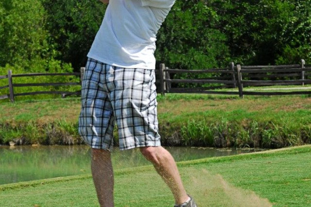 FORT HOOD, Texas- Sgt. Jonathan McManus, a Newton, Kan., native with 3rd Battalion, 82nd Field Artillery Regiment, 2nd Brigade Combat Team, 1st Cavalry Division, takes a little of the green on The Courses of Clear Creak during a golf scramble hosted by his unit, July 7.