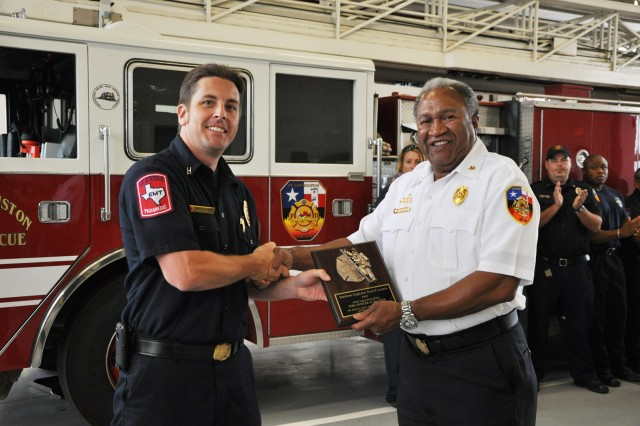 Station Capt. David Lewis (left), named the 2009 FSH Fire Officer of the Year for the Army, receives a plaque from Fire Chief Curtis Williams commemorating his service.
