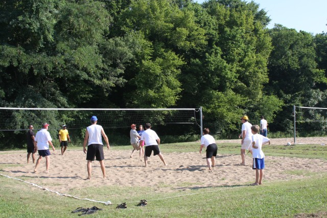 An intense volleyball game during USASMDC/ARSTRAT's organization day tested competitors' athleticism.