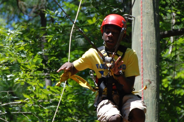 With a yank of the yellow cord, Tory Stephens surrenders himself to gravity as he releases the pulley that has him suspended in the air. With one quick tug, he sets sail through the air swinging from tree top to tree top. Stephens, and many other military youth, experienced the thrill of the giant swing during the Alabama National Guard's 2010 military youth camp.