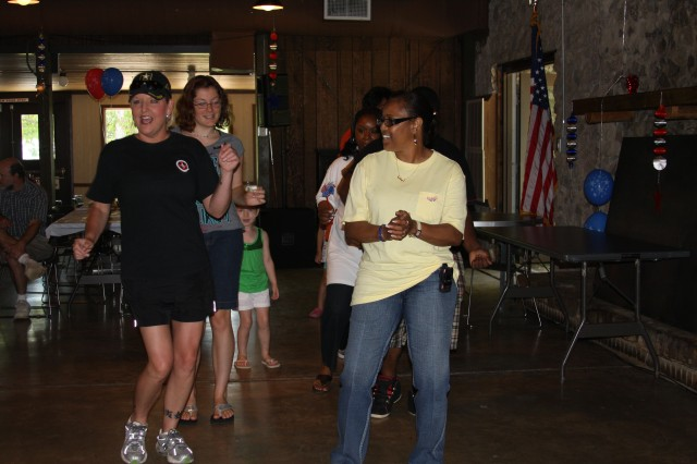 USASMDC/ARSTRAT employees and family members cut loose on the dance floor at the annual Organization Day on July 1 at Redstone Arsenal.