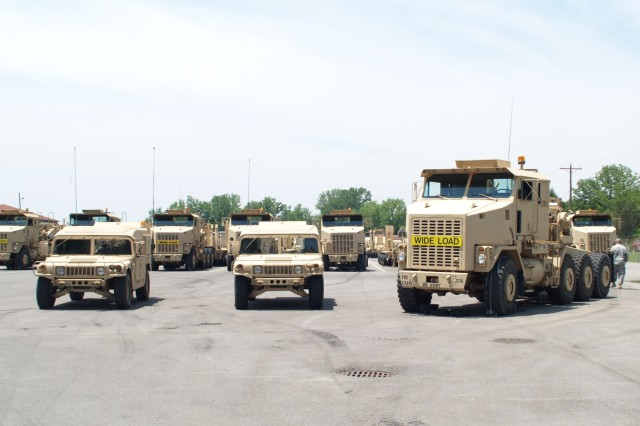 A Soldier from 233rd Transportation Company, parks a HET in Farmer Motor Pool, Fort Knox after a road test. The HET weighs 41,000 pounds - 91,400 with the trailer attached. (U.S. Army Photo by 2nd Lt. Sean Chang)