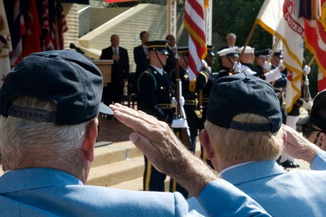 Korean War veterans salute the American flag during a ceremony at the Pentagon, June 24, 2010. The Veterans Affairs Department is changing its regulations in order to ease the claims process and improve access to health care for veterans with post-traumatic stress disorder.