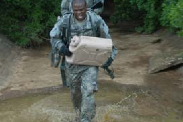 Soldiers with the 46th Engineer Battalion make their way through the swampy Fort Polk woods June 30 during a best squad competition. They were required to carry a member of their team on a litter and water cans as they traversed the terrain.