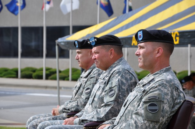 (From left to right) Command Sgt. Maj. Dennis M. Carey, outgoing  command sergeant major of U.S. Army Forces Command; Gen. James D. Thurman, FORSCOM commander; and Command Sgt. Maj. Ronald T. Riling, incoming FORSCOM command sergeant major; sit at the change of responsibility ceremony July 12, at Fort McPherson, Ga.