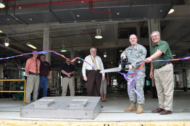 CAAA Commander Col. Charles Kibben and CAAA Supervisory Program Manager Don Neukam cut the ribbon at the renovated melt/pour facility.