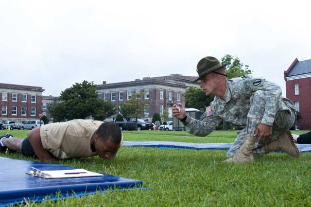 Spec. Qadree Smith, a human resources specialist for the 217th Military Police Detachment on Fort Jackson, S.C., is tested on upper body strength and endurance during the 2010 U.S. Army Training and Doctrine Command Noncommissioned Officer and Soldier of the Year Competition on Fort Monroe, Va., July 13. The competitors completed the Army Physical Fitness Test early on the second day of the competition. (U.S. Army photo by Sgt. Angelica Golindano)(RELEASED) 100713-A-0928G-007