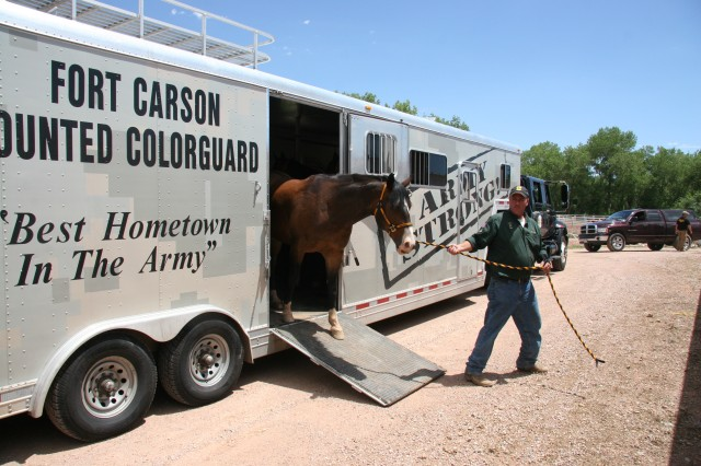 FORT CARSON, Colo.-The Fort Carson Mounted Color Guard horses are off-loaded at the Norris-Penrose Arena July 13 in preparation for their appearance at the Pikes Peak or Bust Rodeo July 14.