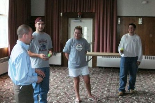 "Rick Bosch leads FMWR operations Manager Joe Kurzontkowski and Recreation Assistants Elizabeth Maloney and Andrew Parker through the FMWR ""Operation Excellence""  customer service training session recently held at the Lord Community Activities"