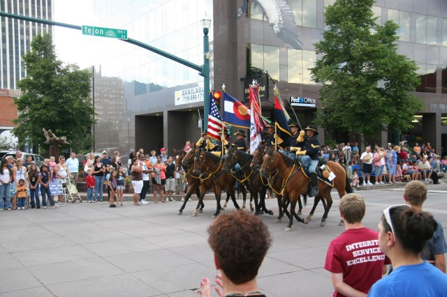 COLORADO SPRINGS, Colo.-The Fort Carson Mounted Color Guard leads the Pike Peak or Bust Rodeo Parade July 13. The rodeo raises funds for local military charities.