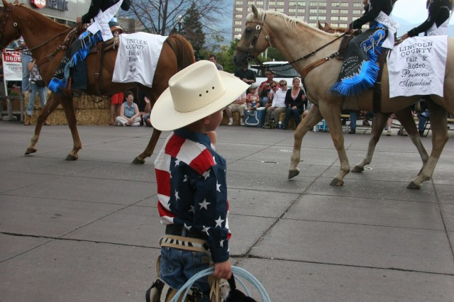 """COLORADO SPRINGS, Colo.-A """"cowboy"""" waves to rodeo queens the Pike Peak or Bust Rodeo Parade July 13. The rodeo raises funds for local military charities."""