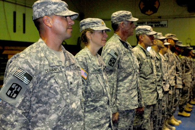 Soldiers stand in formation during their welcome home ceremony held by the 21st Combat Support Hospital, 1st Medical Brigade, 13th Sustainment Command (Expeditionary) at Fort Hood, Texas July 8. The medical personnel came from various units across the country through the Army's Professional Filler System, or PROFIS, which fills any voids for units prior to a deployment. (U.S. Army photo by Pfc. Sean McGuire)