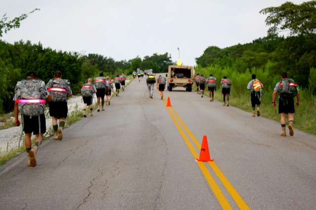 Soldiers from the 53rd Quartermaster Company, 553rd Combat Sustainment Support Battalion, 4th Sustainment Brigade, 13th Sustainment Command (Expeditionary) conducted a 3.75 mile foot march July 8 at Fort Hood, Texas. Each troop carried 40 - 60 pounds on their backs. (U.S. Army photo by Spc. Ann Marie White)