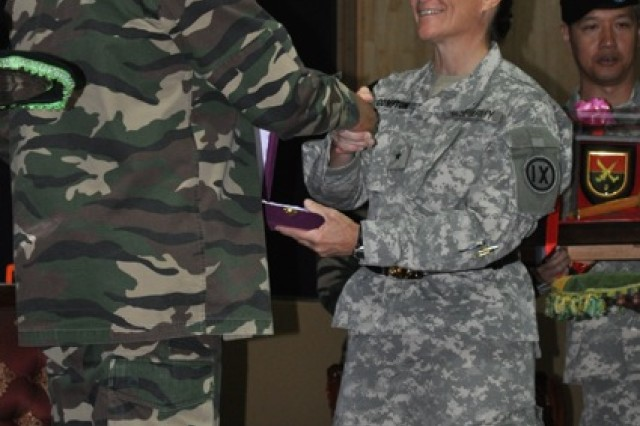 Brig. Gen. Michele G. Compton, the commanding general of U.S. Army Reserve's 9th Mission Support Command and Maj. Gen. Dato' Razali Bin Hj Ahmad, the commanding general of Malaysia's 3rd Division, exchange gifts during the opening ceremony of Keris Strike 2010, July 12.