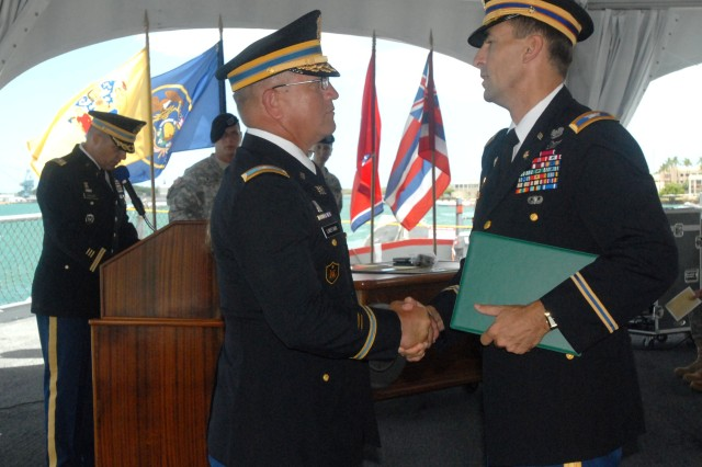 U.S. Army, Pacific, Chief of Staff Col. Thomas Ball thanks Col. Benjamin Lukefahr for his service during a retirement ceremony for Lukefahr conducted the deck of the USS Missouri.