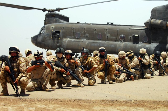 Iraqi commandos with the 10th Iraqi Army Division line up in preparation for a training mission after unloading from a CH-47 Chinook helicopter at Forward Operating Base Garryowen, Iraq, June28.