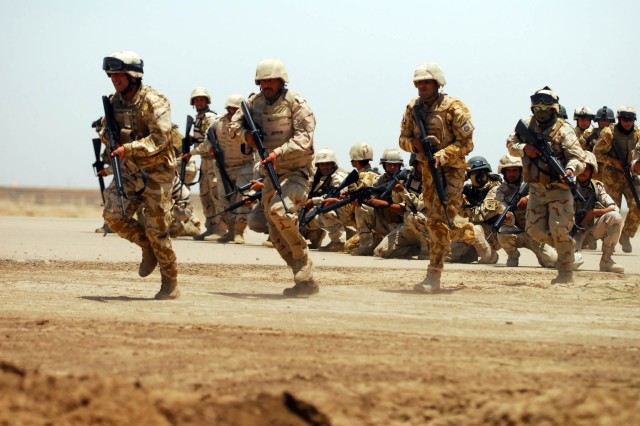 Commandos with the 10th Iraqi Army Division run into position in preparation for a mock infiltration mission at Forward Operating Base Garryowen, Iraq, June 28