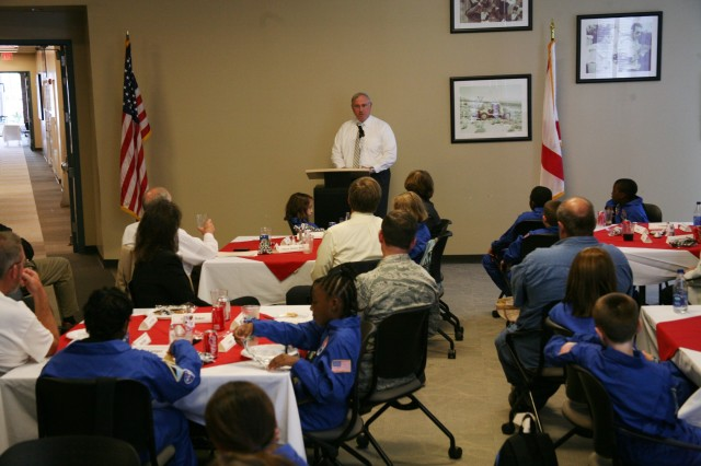 Bob Pollard, president of the Air, Space, and Missile Defense Association, speaks to Space Camp scholarship recipients, other ASMDA members, a few parents and the team lead during a luncheon July 7 at the U.S. Space and Rocket Center. ASMDA provided the scholarships for the children to attend Space Camp.