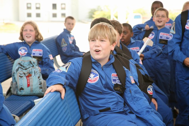 Davis Toomey, 11, talks to members of the Air, Space, and Missile Association and other scholarship recipients during a break from Space Camp July 7 at the U.S. Space and Rocket Center. Toomey is one of 16 children who received scholorships for Space Camp from ASMDA from across the country. He is a seventh grader in Huntsville, Ala.