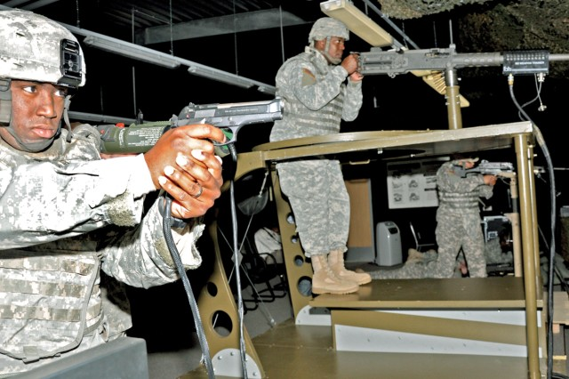 Spc. Blair Flowers, 1st Armored Division Special Troops Battalion Rear Detachment, takes aim along with fellow Soldiers in the Engagement Skills Trainer in the new consolidated Wiesbaden Training Support Center.