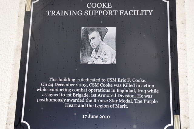 A plaque honors Command Sgt. Maj. Eric F. Cooke of 1st Armored Division\'s 1st Brigade. Cooke was killed in action in Iraq in 2003.