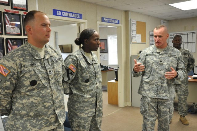 Lt. Col. Bryan Hernandez, right, commander of the 3rd Battalion, 34th Infantry Regiment, praises Sgt. 1st Class Kimberly Burns, middle, and Staff Sgt. Phillip White for their quick actions in aiding a Basic Combat Training Soldier who stopped breathing during a classroom exercise.