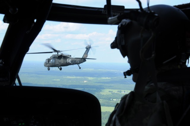 Student-pilot WO1 Ian Reid follows another UH-60 Black Hawk in formation while returning to Lowe Army Airfield after conducting a Ranger transportation mission at Eglin Air Force Base, Fla., July 7.