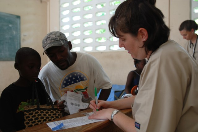 Air Force Maj. Teresa Stump, a physician with the 56th Medical Group, gives the local patients instructions on how to take their medication at the U.S. Army South New Horizons- Haiti 2010 Ennery medical assistance site July 13. New Horizons, in partnership with the government of Haiti, is conducting various medical, dental and engineering missions for the locals in Gonaives. New Horizons also provides valuable learning experience in a real-world environment for our U.S. Forces. (U.S. Army Photo by Spc. Jessica M. Lopez/Released)